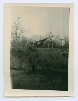 Primary view of object titled '[Man With a Rifle in a Field]'.
