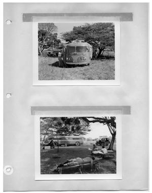Primary view of object titled '[Custom Bus at Shady Campsite] and [Men Relaxing in Shady Campsite]'.