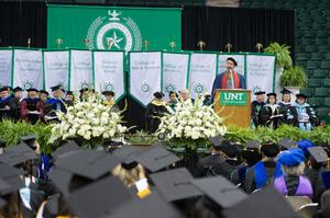 Primary view of object titled '[Warren Burggren speaking at UNT Fall Commencement]'.