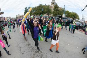 Primary view of object titled '[People walking in UNT homecoming parade]'.