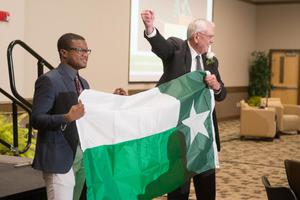 Primary view of object titled '[V. Lane Rawlins with UNT flag]'.
