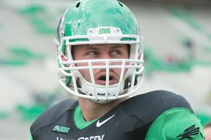 Primary view of object titled '[UNT Mean Green football player]'.