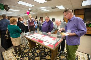 Primary view of object titled '[LGBT event attendees examining display]'.