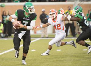 Primary view of object titled '[Football Players during UNT Homecoming game]'.
