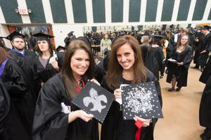 Primary view of object titled '[Students with decorated mortarboards at UNT Commencement]'.