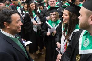 Primary view of object titled '[Neil Foote with students at UNT Commencement]'.