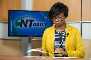 Primary view of object titled '[Photograph of NTTV reporter]'.