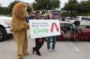 Primary view of object titled '[Dorothy Bland with sign at homecoming parade'.