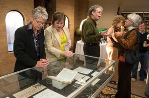 Primary view of object titled '[Visitors looking at display case at LGBT event]'.