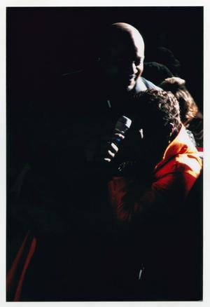 Primary view of object titled '[Peabo Bryson Embracing Guest During Performance]'.