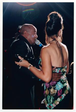 Primary view of object titled '[Peabo Bryson Singing with Arm Around Guest]'.