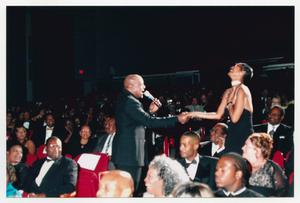 Primary view of object titled '[Peabo Bryson Singing to Audience Member]'.