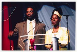 Primary view of object titled '[Timothy Stickney and Phyllis Yvonne Stickney at Podium]'.