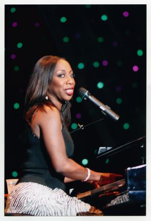 Primary view of object titled '[Oleta Adams Performing on Stage]'.