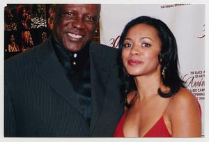 Primary view of object titled '[Louis Gossett Jr. with Guest]'.