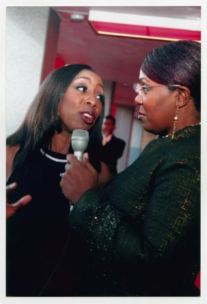 Primary view of object titled '[Oleta Adams Speaking into Microphone on Red Carpet]'.