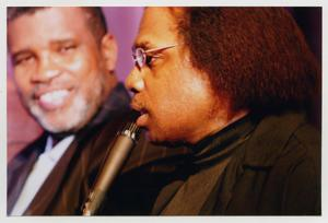 Primary view of object titled '[Curtis King on Stage with Guest]'.