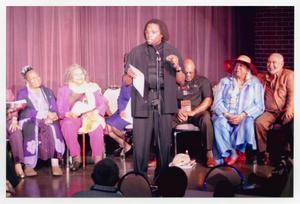 Primary view of object titled '[Curtis King on Stage with Several Guests]'.
