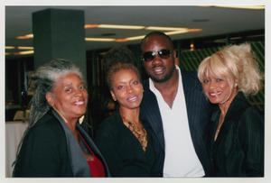 Primary view of object titled '[Malik Yoba with Three Guests]'.