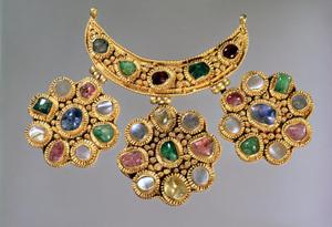 Crescent shaped necklace with pendants set with semi precious stones