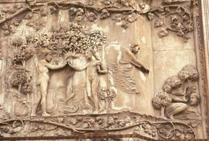 Primary view of object titled 'Adam and Eve Eating the Forbidden Fruit and God Discovering Them, north doors trumeau relief, Orvieto Cathedral, Orvieto, Italy'.