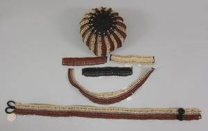 Primary view of object titled 'Parure - Hat, Bracelets, Necklace, Belt'.