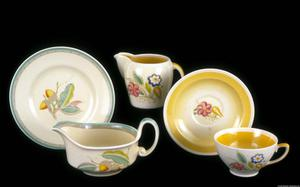 Primary view of object titled 'Susie Cooper Earthenware Ceramics, Gravy Boat, Plate, Creamer, Cup and Saucer'.
