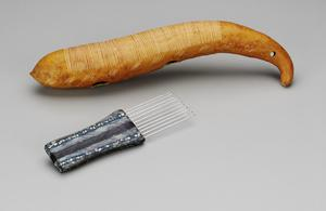 Primary view of object titled 'Scraper and Comb (Raspa)'.