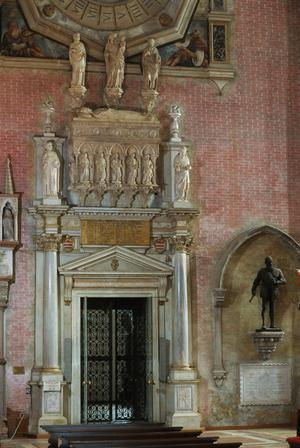 Primary view of Tomb of Doge Antonio Venier (d. 1400) with entrance to Chapel of the Rosary and modern statue of Admiral Sebastiano Venier, hero of Battle of Lepanto