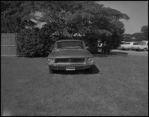 Primary view of object titled '[Mustang Parked on Lawn]'.