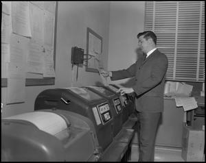 Primary view of object titled '[WBAP-TV Employee Reading From a Teleprinter]'.