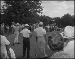 Primary view of object titled '[WBAP-TV Workers Filming Golf Event]'.
