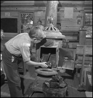 Primary view of object titled '[Boy loading furnace]'.
