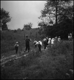Primary view of object titled '[Children walking along a path]'.