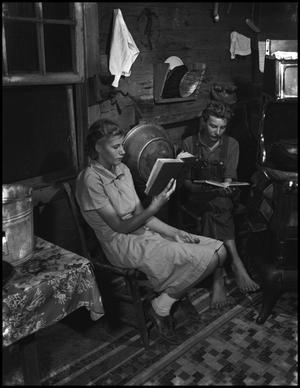 Primary view of object titled '[Otto Walker and sister reading]'.