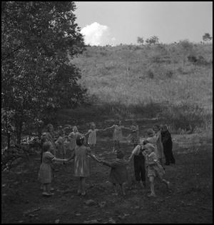 "Primary view of object titled '[Children playing ""drop the handkerchief""(2)]'."