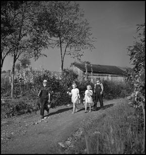 Primary view of object titled '[Boys and girls walking along a country road(1)]'.