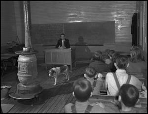 Primary view of object titled '[Teacher, students, and dog in classroom]'.