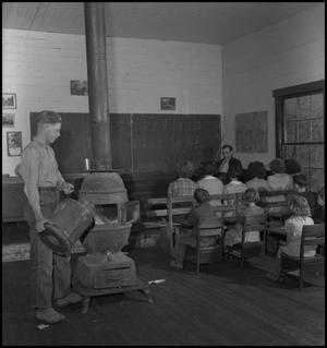 Primary view of object titled '[Loading the classroom furnace]'.
