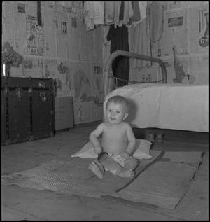Primary view of object titled '[Baby in bedroom]'.