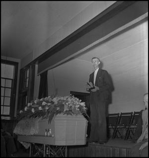 Primary view of object titled '[Mountain Funeral: Reverend's Sermon]'.