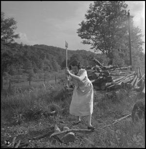 Primary view of object titled '[Chopping wood]'.