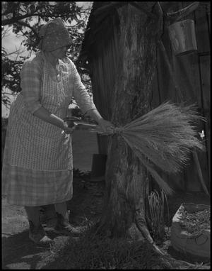Primary view of object titled '[Tying a broom]'.