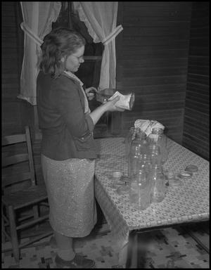 Primary view of object titled '[Cleaning the jars]'.