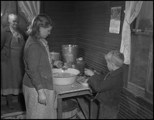 Primary view of object titled '[Straining the apples]'.