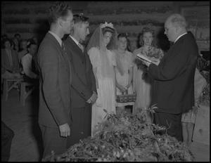 Primary view of object titled '[Gilbert Dove and Hazel Petrey at the altar]'.