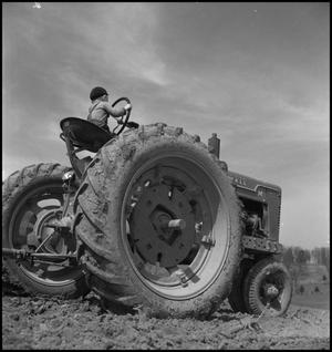 Primary view of object titled '[Mika on tractor]'.