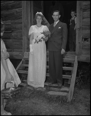 Primary view of object titled '[Bride and groom pose for pictures]'.
