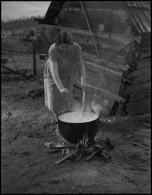 Primary view of object titled '[Stirring a boiling pot]'.