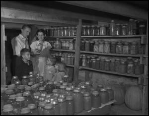 Primary view of object titled '[Family in root cellar]'.